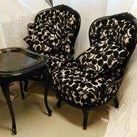 Rokokoo chairs painted black and upholstered with Designers Guild fabric