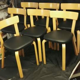 Artek dining chairs reupholstererd with leather from Elmo