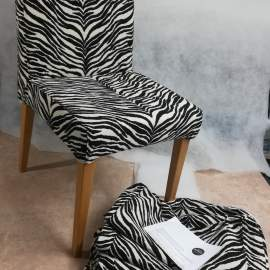 Dining chairs with loose covers in zebra fabric